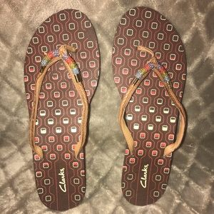 Clarks Brown beaded and braided flip flop
